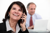 A businesswoman over the phone. — Stock Photo