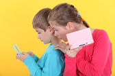 Children with handheld computer games — Stock Photo