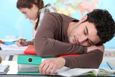 Young man sleeping during a university lecture — Stock Photo