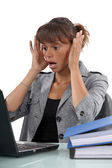 Distressed woman with laptop — Stock Photo