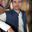 Man stood in wine cellar - Foto Stock