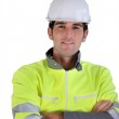 Man in a safety jacket and helmet — Stock Photo