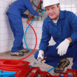 Stock Photo: Plumbers at work