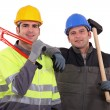 Construction workers with bolt cutters and a sledgehammer — Stock Photo #7622370