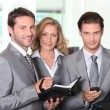 Stock Photo: Business colleagues smiling
