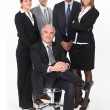Young business team standing behind their boss — Stock Photo