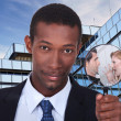 A black man showing a couple dispute through a magnifying glass - Stock Photo