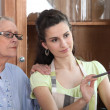 Young woman helping senior lady with the cleaning — Stockfoto