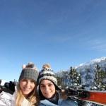 Portrait of best friends at ski resort against deep blue sky background — Stock Photo