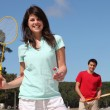 A couple playing badminton — Stock Photo #7623577
