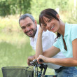 Man and woman out for a bike ride in the country — Stock Photo #7623653