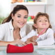 Stock Photo: Teacher with a little girl