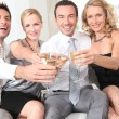 Two couples drinking champagne together — Stock Photo #7623854