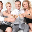 Two couples drinking champagne together — Stock Photo