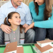 Young family planning their new house — Stock Photo