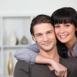 Young couple at ease together at home — Stock Photo #7624143