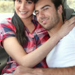 Young couple sat in car — Stock Photo
