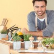 Smiling chap relaxed in his kitchen — Stock Photo