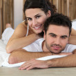 Woman laid on man - Stock Photo