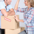 Couple with boxes smiling — Stock Photo