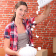 Portrait of a woman with moving box - Stock Photo
