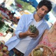 Man and woman shopping vegetables — Stock Photo