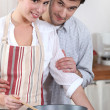 Couple cooking in their kitchen — Stock Photo #7624329