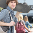 Teenager with skateboard — Stock Photo #7624404