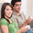 Stock Photo: Young playing video games