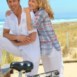 Stock Photo: Couple cycle to sea