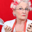 Stock Photo: Senior womwith hair curlers