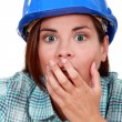 Royalty-Free Stock Photo: Shocked woman wearing a hard hat
