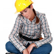 Sad female construction worker - Stock Photo