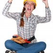 Foto de Stock  : Ecstatic female construction worker.