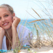 Attractive blond woman laid on the beach — Stock Photo
