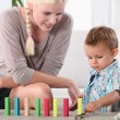 Mother and son playing with domino's — Stockfoto