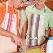 Stock Photo: Father and son cooking