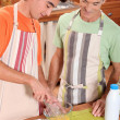 Foto de Stock  : Father and son cooking