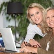 Mother and daughter together at home — Stock Photo