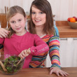 Mother and daughter making salad — Stock Photo