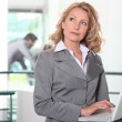 Businesswoman at workplace with laptop — Stock Photo #7625591