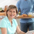 Man bringing his wife breakfast on a tray — Stock Photo #7625660