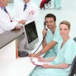 Nurses and doctors in a hospital reception — Stock Photo