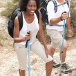 Couple hiking with sticks — Stock Photo