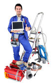 Plumber with laptop — Stock Photo