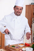 Chef preparing a meal — Stock Photo
