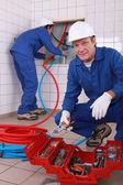 Plumbers at work — Stock Photo