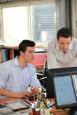 Twosome of male employees in office — Stock Photo