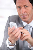 Businessman on mobile phone — Stock Photo