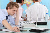 Exasperated man working at a laptop — Stock Photo